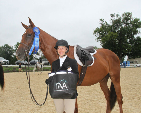 Rachel Lallier and Accountable winners of adopted horse class 2018