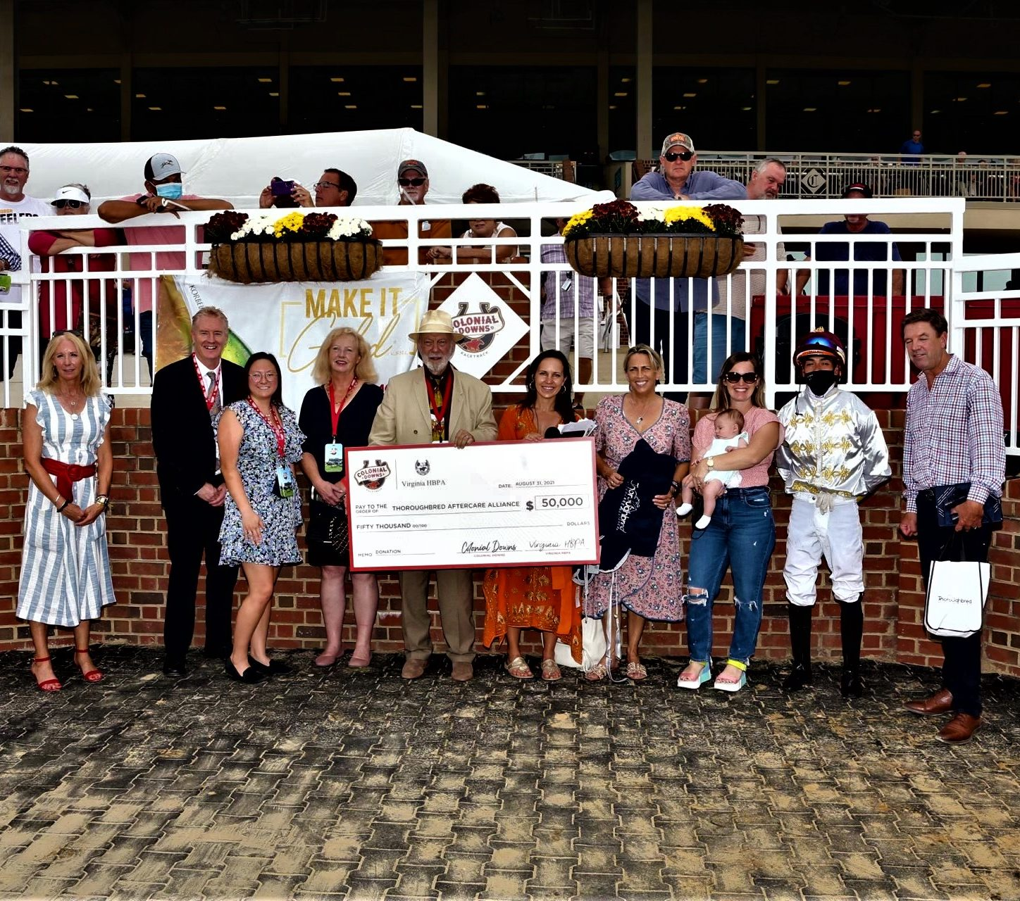 Colonial Downs, Virginia HBPA Present Check to TAA on Virginia Derby Day